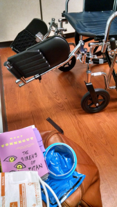a picture of Sirens of Titan and a wheelchair